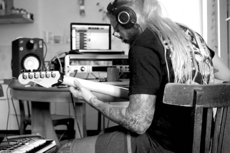 Anthony Chognard works on guitar pre production